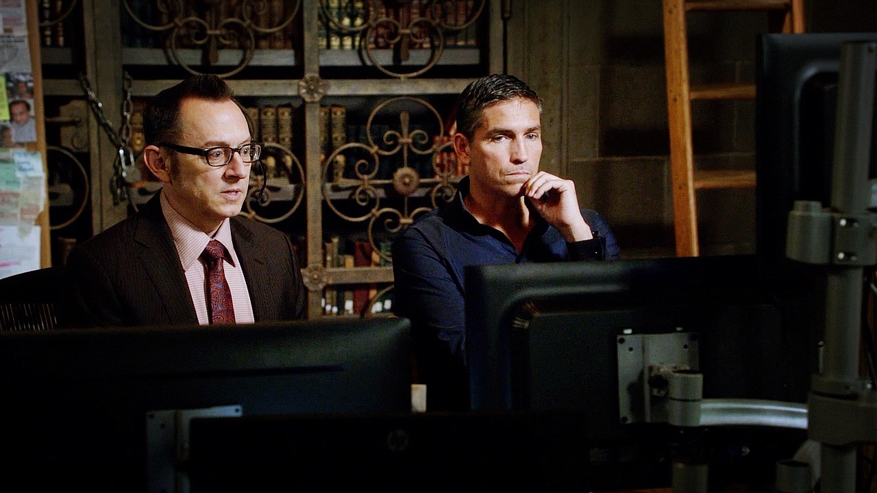 Photo of Reese and Finch at a bank of computer screens