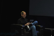Steve in a chair with the Apple iPad